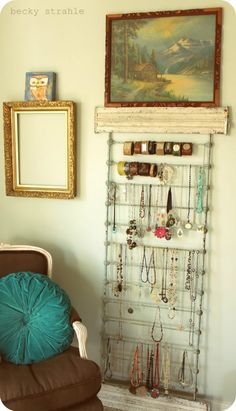 side of crib as jewelry organizer.  genius.  Especially since I have one lying around!  Plus LOVE everything about this house.  tons of decorating inspiration.