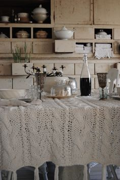 a sweater-knit tablecloth adds warmth to this table setting!