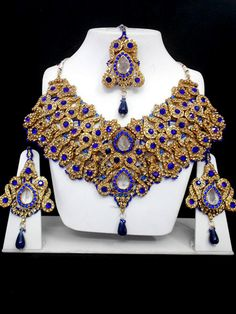 The Very Exclusive Indian Patwa Jewelry  sets available with matching pair of  earrings and mangtikka. The speciality of  this jewelry set is its gorgeous looks  which is beatifully handcrafted work with  high quality Cubic Zirconia (CZ) stones  and the beads of different size, color and  shape which makes its more lookrative.  This patwa jewelry set is also worn as  bridal jewelry or semi bridal jewelry.    Visit www.impexfashions.com
