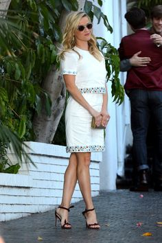 Reese Witherspoon showing off her fabulous legs in akle strap high heels