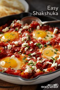 Shakshuka - eggs cooked in a rich tomato and veggie sauce; this is a MUST make every weekend! It's not only any easy one skillet meal, it's hearty breakfast to satisfy the whole family!