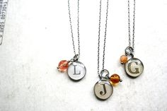 the neatest monogram necklaces i've seen in a long time.