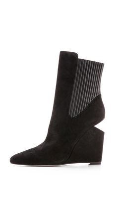 I found this #Alexander_Wang_Andie_Wedge_Booties_-_Black #shoe at Zappos and look-alikes on #LookAllure app: