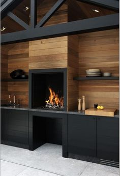 fireplace with wood storage underneath and nice built ins. Good color use as well