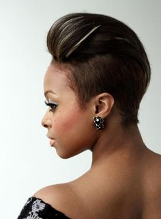 A Volumized Pompadour: For a little more height, tease the front section into a bouffant and set with hairspray.