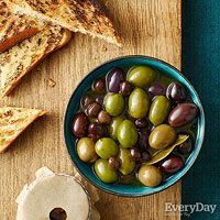 Martini-Marinated Olives ~also keep pits out of sight by cutting a small hole in parchment and tying it over the top of a cup or mug