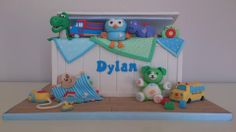 Toy box cake with toys! - *A toy box cake with tiny, edible versions of all of the birthday boy's favourite toys!