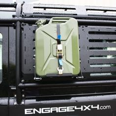 Jerry can holder foldable by is universal and useful. This practial product for expeditions is developed by Land Rover specialist Defender Camper, Land Rover Defender 110, Ford F150 Accessories, Truck Accessories, Toyota Lc, Toyota 4runner, Off Road Camper, Truck Camper, Ford Ranger