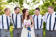 Love the groomsmen in similar pants and shirts with suspenders