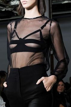 cut-out bra layered under sheer blouse. Costume National ss13