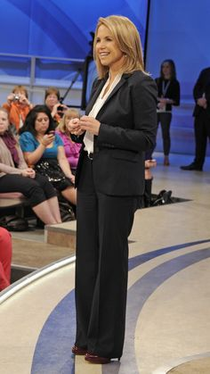 Katie Couric wears a Tucker blouse and a J.Crew suit for an episode of Katie!