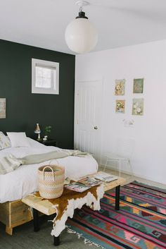 aztec rug, natural wood, gray accent wall