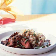 Bourbon and Brown Sugar Flank Steak with Garlic-Chive Mashed Potatoes. The marinade is sooooo good!