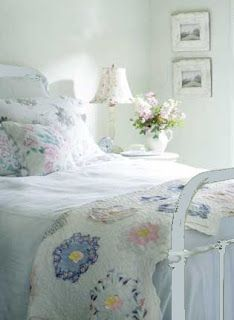 Light and breezy cottage style bedroom with a fabulous quilt at the end of the bed.
