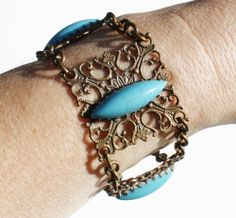 Vintage turquoise filigree bracelet, (sorry about the pale arm we're lacking sun in England)...  intovintage.co.uk