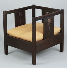 Designed for Gustav Stickley by Harvey Ellis, the inlaid cube chair was made circa 1903. Collection of Crab Tree Farm.