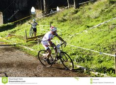 Bikers doing cyclocross at the park of the Acquedotti Cinecitta in Rome.