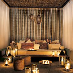 lanterns candles n pillows.. love everything about this room
