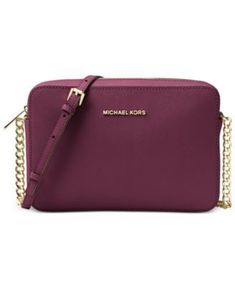 2554e1bbe Get a fresh perspective on cool handbag decorum with this sophisticated yet  street-chic crossbody from Michael Michael Kors. Fashioned in luxe Saffiano  ...