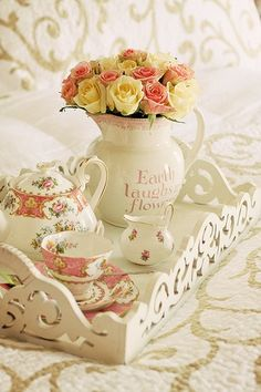 """""""Earth laughs in flowers"""" quote on the jug with an assortment of roses.  #Teatime #rose #arrangement served from a Victorian style wood carved tray."""