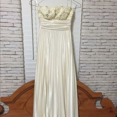 Strapless White Prom Dress Strapless white prom dress with pleating and floral embellishments! Never used! Speechless Dresses Maxi