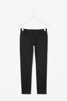 Tapering towards the ankle, these slim-fit jeans are cut from black denim with a soft feel. A classic five-pocket style, they have oxidised metal hardware, button fly fastening and a slight stretch for comfort.