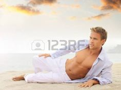 14105138-beach-portrait-of-a-good-looking-young-blond-man-in-white-pants-and-light-blue-shirt-laying-down-loo.jpg (450×338)
