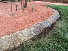 One piece concrete edging.  Poured in place concrete border. Natural appearance.  Looks like mortared rock but won't come apart.