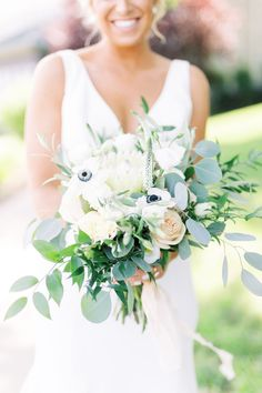 bridal-bouquet-with-white-roses-anemone-eucalyptus-leaves