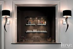 Custom shelves light up the bar.