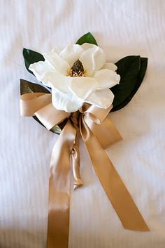This could be pretty for bridesmaids...one statement flower. Maybe add some baby breath