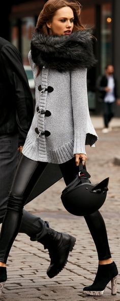 Big Scarf, Gray sweater with black toggles, and leather pants - and LOOK at those booties and bag!