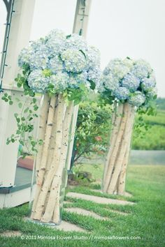 River birch limbs in tall vases with hydrangeas. (we could do this on a smaller scale with my tall vases for centerpieces)