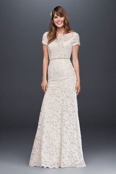 This vintage-inspired allover lace sheath wedding dress flatters from every angle. Short sleeves and an illusion neckline provide delicate coverage while the open back provides a modern touch. Galina