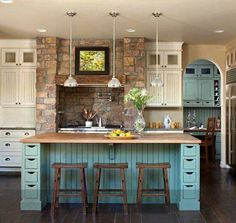 Kitchen with rock details,  blue cabinets.