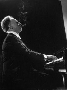 Pianist Arthur Rubenstein at the Piano, Smoking Cigar Premium Photographic Print by Gjon Mili