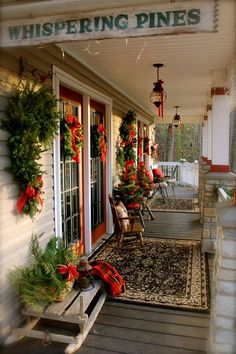 Whispering Pines front porch!!! Bebe'!!! All decorated with pine greens and red ribbons for a festive front porch for the holidays!!!