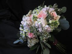 Small open wildflower look hand tied bouquet created with apple blossom stock, sophie roses, peach tulips, white godetia, white Monte casino, pink riceflower, sterling range, plumosa and Florida ruscus. The stems are wrapped in plaid provided by the Bride. Coffee Filter Roses, Mount Airy, Hand Tied Bouquet, Tulips, Wild Flowers, Wedding Flowers, Floral Wreath, Peach, Basket