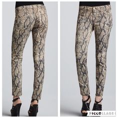 "DL1961 Emma Legging Slither Snake Print These super-slim jeans showcase a runway-inspired print. Emma cut in neutral snake-print stretch twill. Cross-weave technology provides four-way stretch, creating 90% less pressure at stress points including the knees, inseam, and back rise. Mid 8"" rise; contoured waistband; 13"" back rise. Fitted through skinny legs; 10"" leg openings. Ankle-length; 14"" waist 28.4""inseam. Faux front pocket style. Worn once. Like new. DL1961 Jeans Skinny"