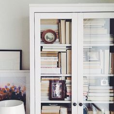 stack books spine back to reveal pages... totally different dimension & great neutral backdrop for bookcase trinkets.