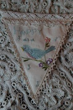 use vintage linens to make pennant banner