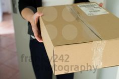 Woman receiving parcel - royalty free photos by franky242 photography - buy and download this photo online