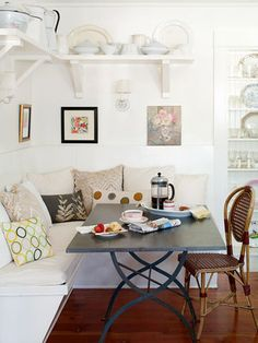 Decorative pillows add character to this cozy banquette. Get banquette design tips: http://www.bhg.com/rooms/dining-room/themes/banquette-design/?socsrc=bhgpin072312cozybanquette