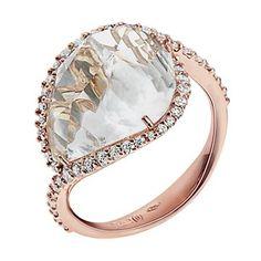 Anello in oro rosa e diamanti, con cristallo di zaffiro centrale arrotondato e sfaccettato