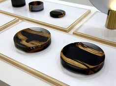 ink and wash series by EY products delicately fuses ebony wood and resin
