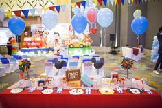 Just how adorable is this Tsum Tsum goes to Europe 1st Birthday party? Love the Mickey Mouse centerpiece!! See more party ideas at CatchMyParty.com