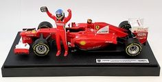 """2012 Ferrari F2012 #5 driven by Fernando Alonso to victory at the 2012 Formula 1 Malaysian Grand Prix. Includes Alonzo figure, mounted to display. Individualized serial numbered on face plate, 3500 total produced. 1:18 Scale, Approximately 11"""" long. Manufactured by Hot Wheels Racing. Part # BBW94. Click on the picture for more information about this diecast car!"""