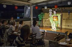 A Maiko performs in a tea house in the Geisha's district of Gion...