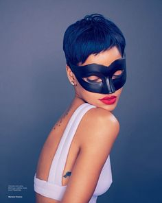 Rihanna shows off her rebelliously chic style for the April cover story of Elle UK.