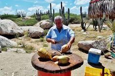 Vendor selling fresh coconut